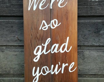 """Handpainted Reclaimed Wood """"We're So Glad You're Here"""" Sign"""