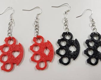 Knuckleduster earrings with card suit cutout. 3D printed.