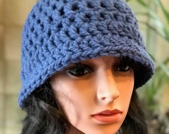 Women's floppy hat in periwinkle blue .