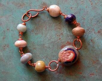 Bijou de Lotus / Double face Perle en céramique et Bracelet en cuivre