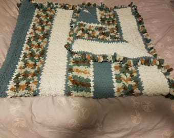 Light turquoise,  brown and very light turquoise chunky afghan