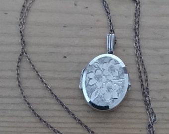 Vintage sterling silver engraved oval shaped locket