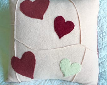 Pink wool pillow with hearts
