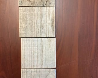 Four rustic pieces of sanded wood for projects
