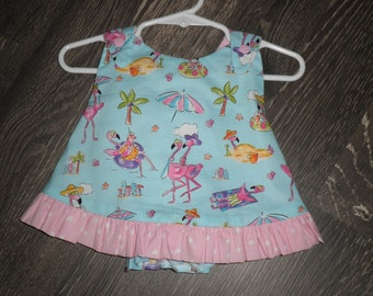 ruffled pinafore dress with matching bloomers for baby.
