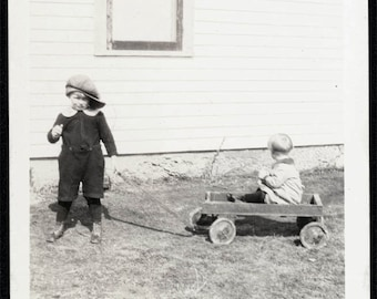vintage photo Boy in Dads Cap Baby in Wagon by House
