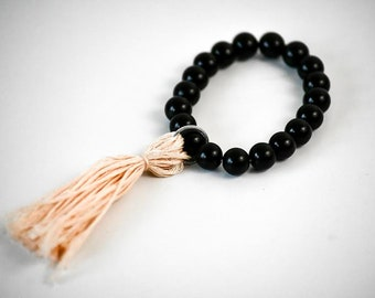 Black Beaded/Light Pink Tassel Bracelet