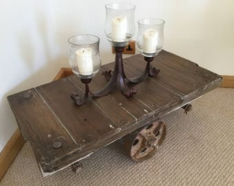 SOLD SOLD SOLD Vintage Industrial Trolley Coffee Table with Cast Iron Wheels