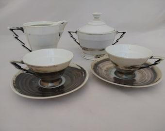 Art deco, sterling silver on porcelain German cups, saucers, sugar bowl and milk jug