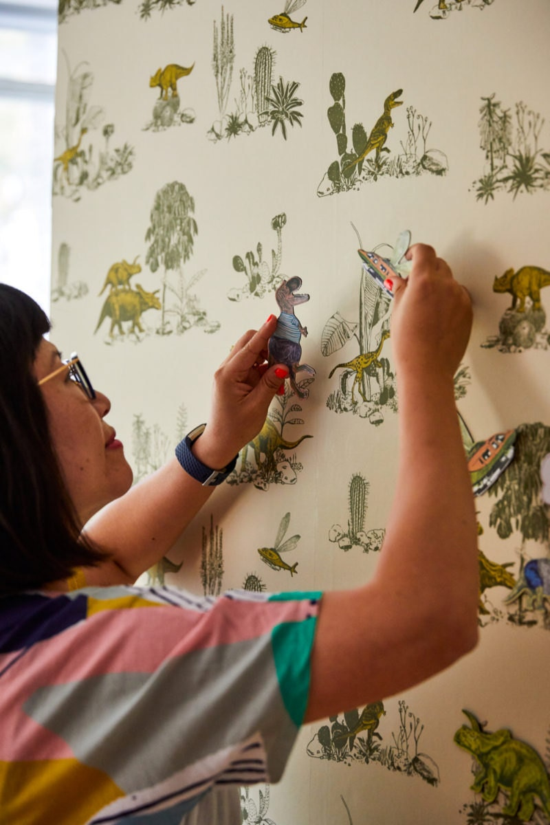 Sian demonstrates how to use the magnetic characters that go with her dinosaur wallpaper design.