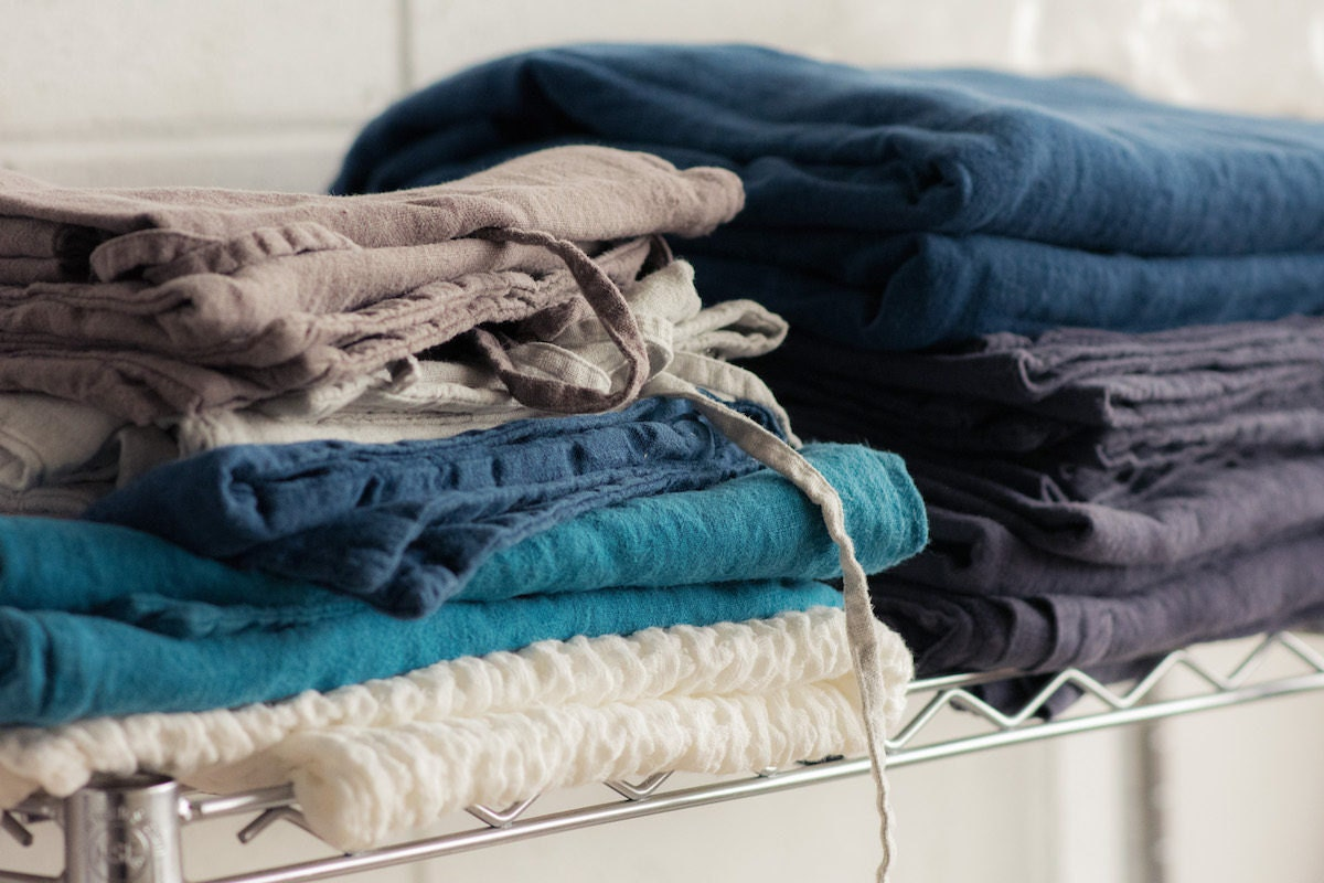 Linen stacked in the House of Baltic Linen studio