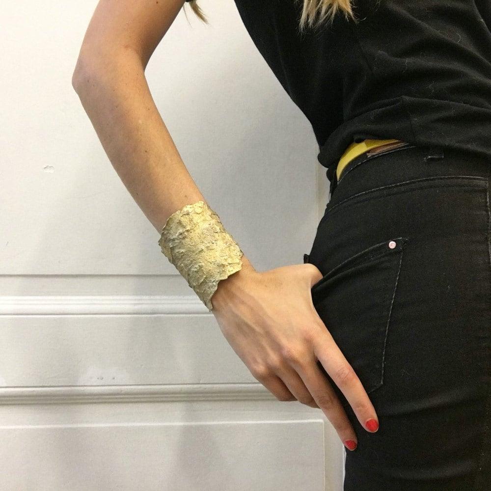 A cuff bracelet modeled after pine bark from Mai Solorzano