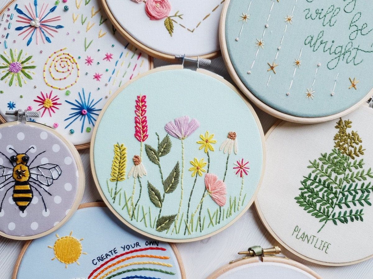 A pile of completed embroidery hoop art from Natalie Gaynor Designs