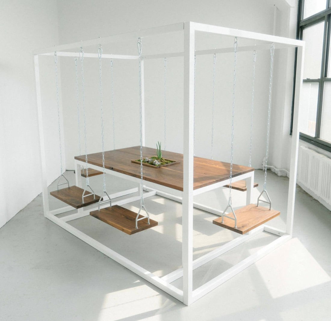 A dining table with swinging seats from Swing Tables