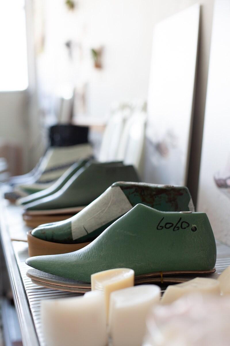 Shoe forms in Hadas's studio