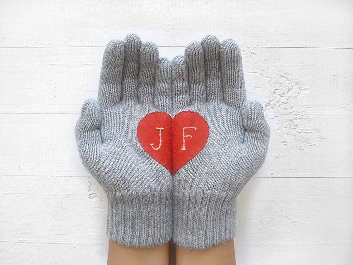 A pair of hand-embroidered monogrammed gloves.