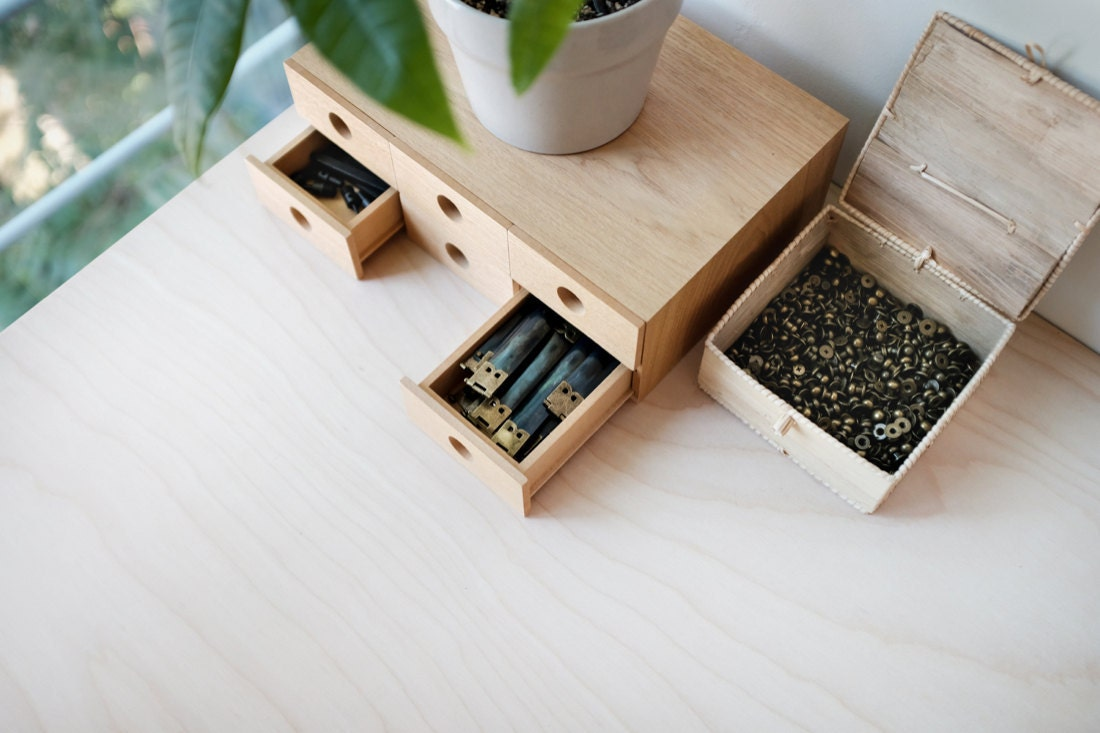 Drawers of metal fittings and other handbag hardware