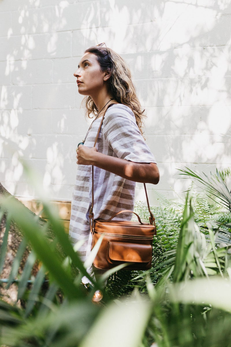 Jacqueline walking with one of her leather camera bags