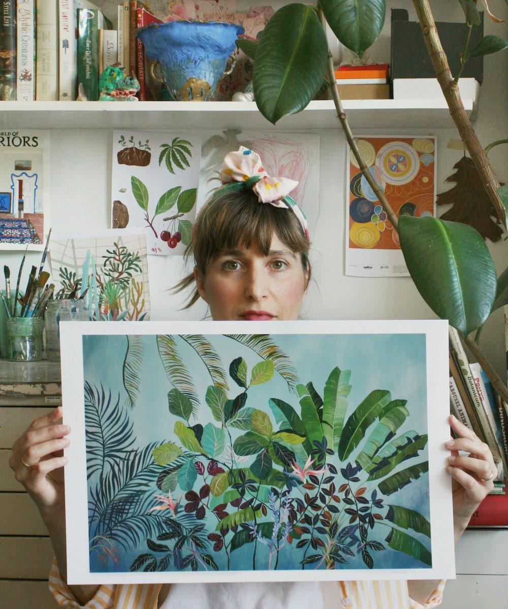"Painter Laura Garcia Serventi posing with her ""Birds of Paradise"" botanical art print."