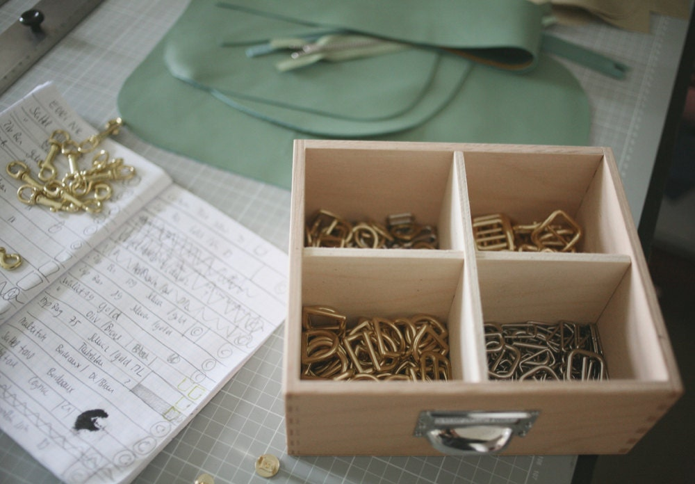 A drawer full of gold and silver fittings