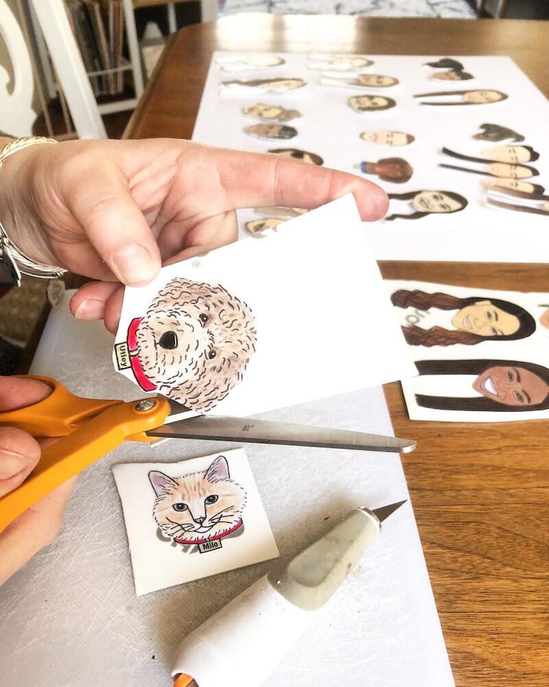 Regina cuts out a custom dog illustration