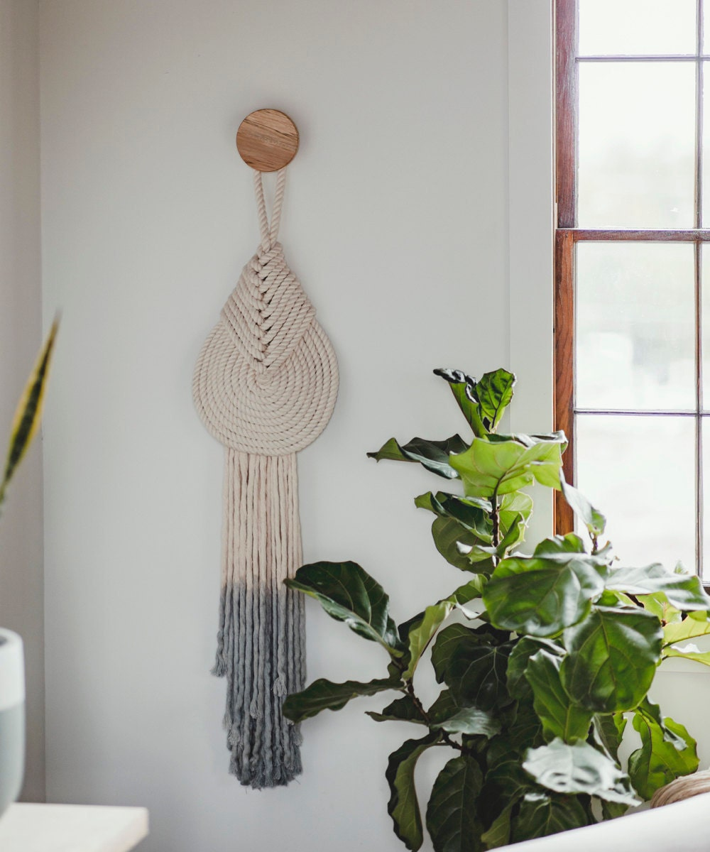 """A medium """"Lyric"""" macrame wall-hanging with accent knob from Candice Luter."""