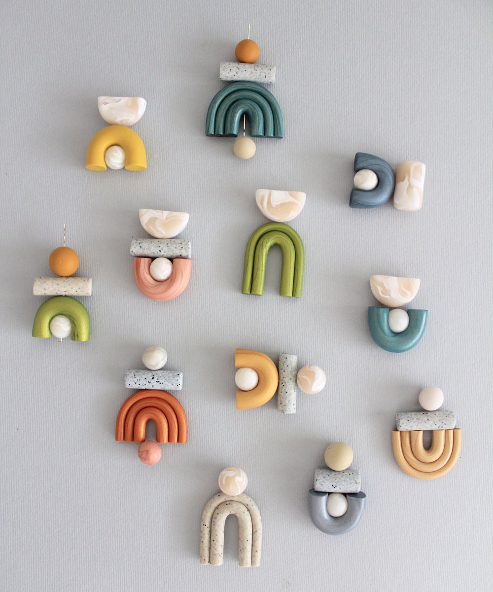 Colorful flat lay of assembled earring patterns before the hooks are added.