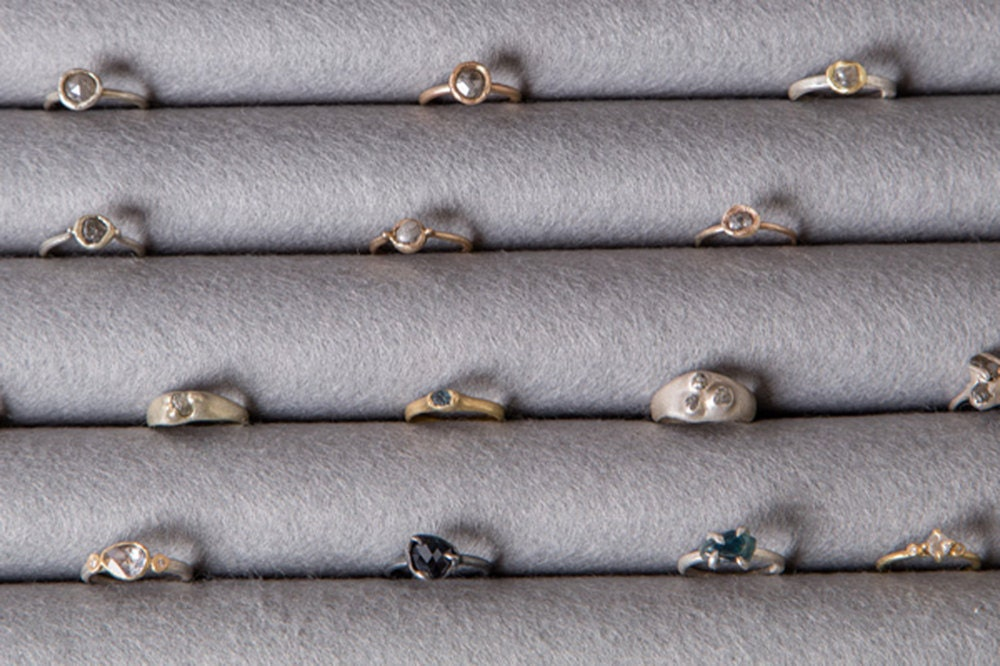 Assorted rings from Tamara Gomez, stored in tidy rows