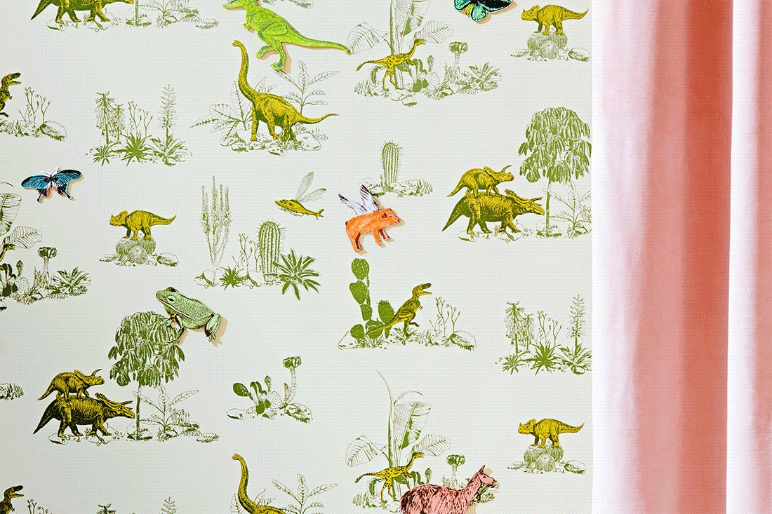 A gif of Sian's award-winning dinosaur wallpaper showing the magnetic characters moving about the wall.