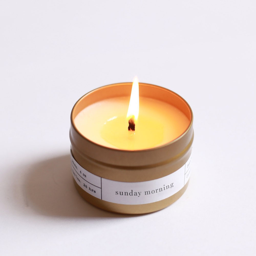 A soy wax travel candle in a brushed gold tin from Brooklyn Candle Studio.