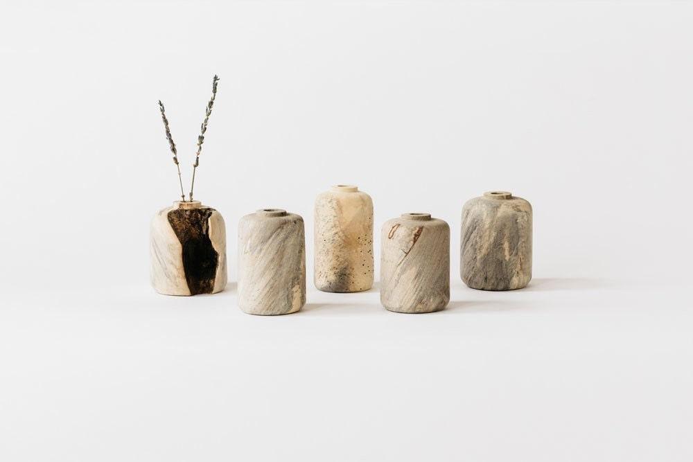Unfinished buck-eye burl bud vases from Melanie Abrantes