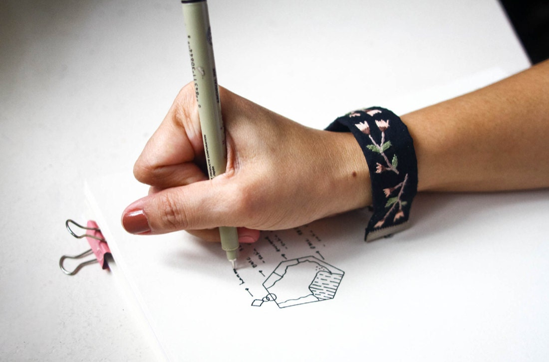 Ruby sketches out one of her geometric earring designs