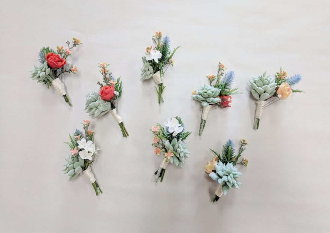 A sample of assorted succulent boutonnieres from The Faux Bouquets