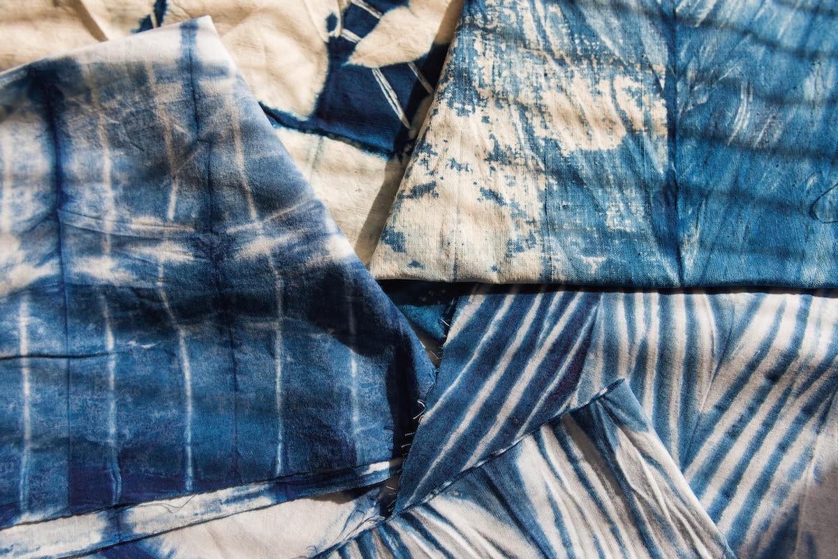 An array of hand-dyed indigo fabrics