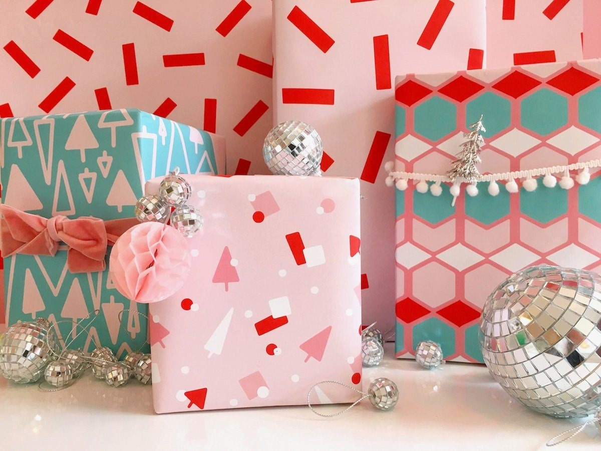 Festively wrapped holiday packages in neon bright colors