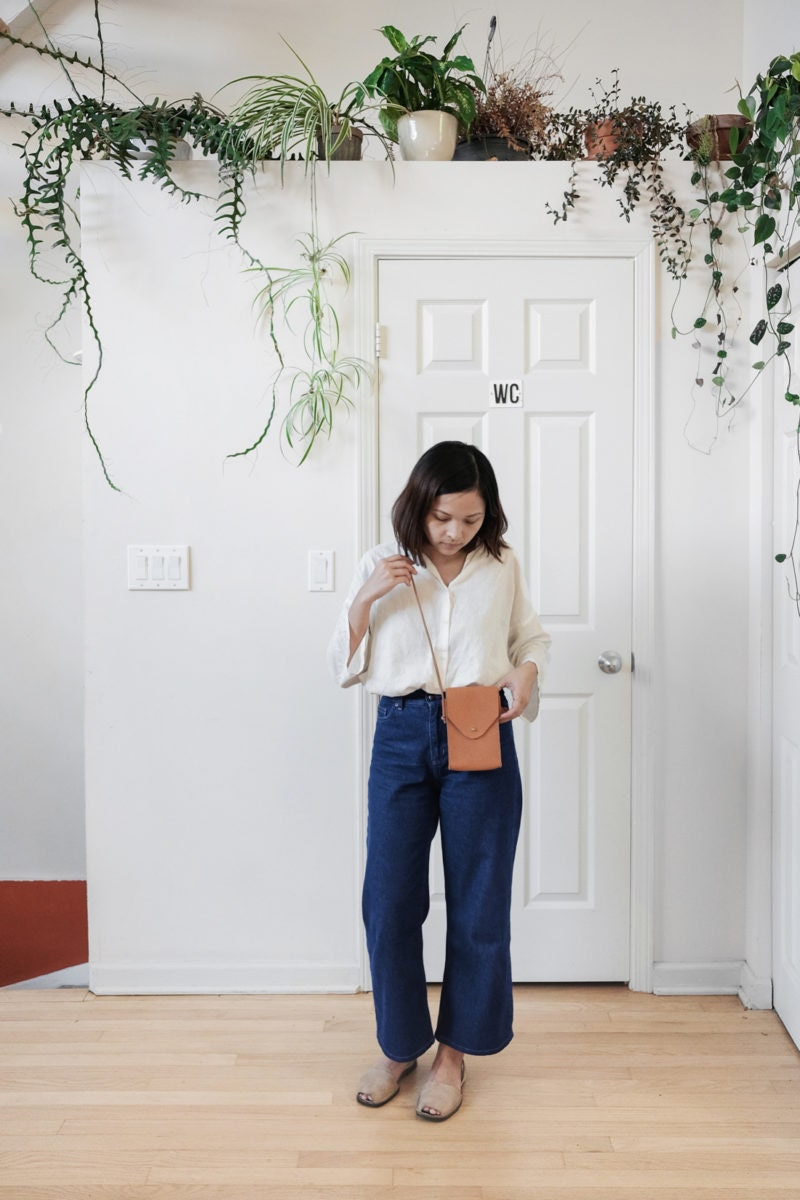 Quynh models a handmade leather phone sling