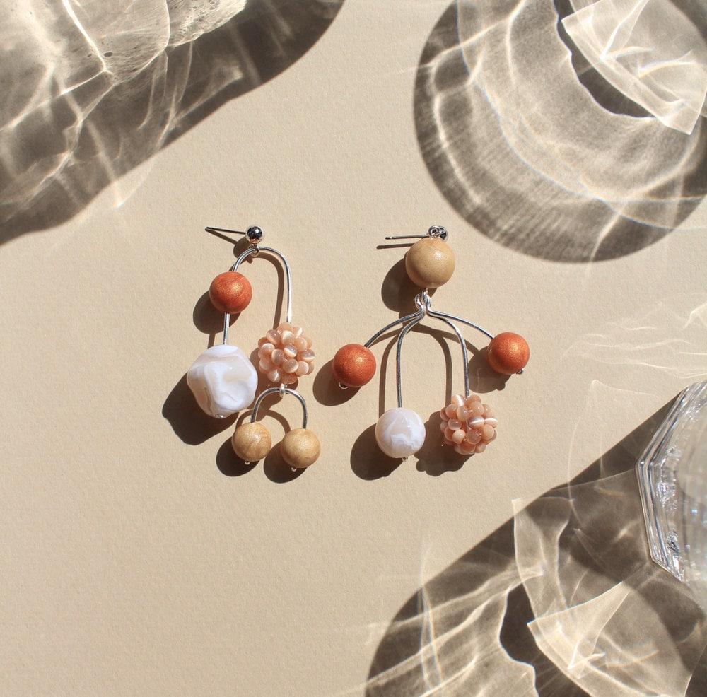 Asymmetrical mobile statement earrings from TSUNJA