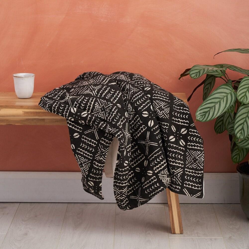 A mud cloth throw blanket from Bespoke Binny