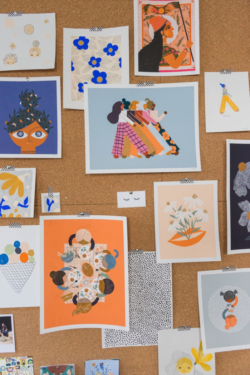 Assorted prints and pattern swatches pinned to Meenal's bulletin board
