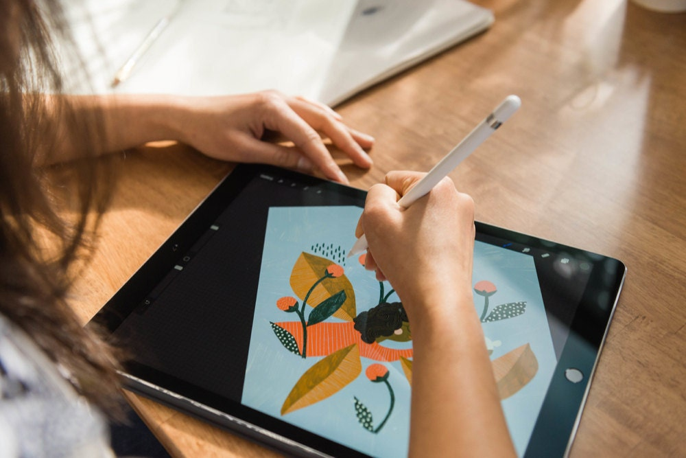 Meenal adds pattern and shading to a drawing on her tablet