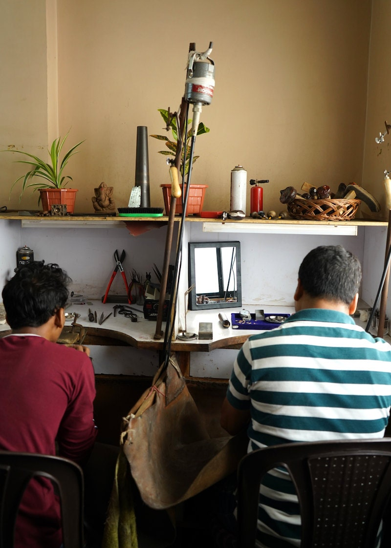 Two members of the Abhika Jewels team at work in their Delhi studio