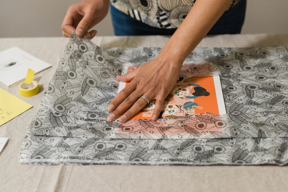 Meenal packages a print for a customer