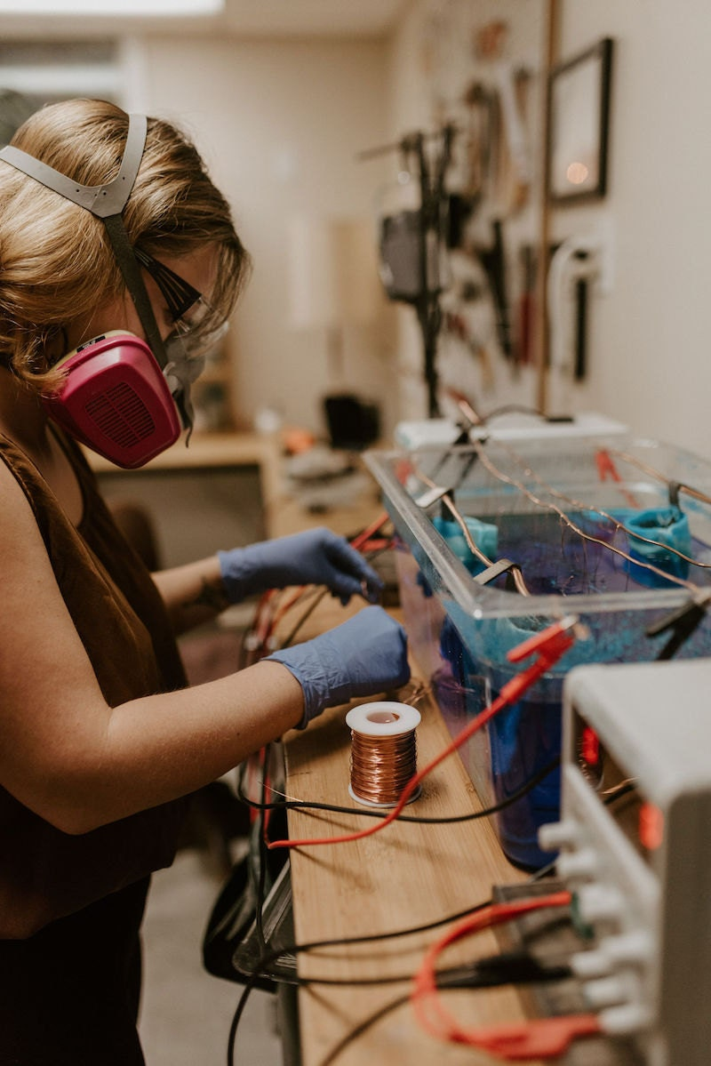 Alicia at her electroforming station in her studio