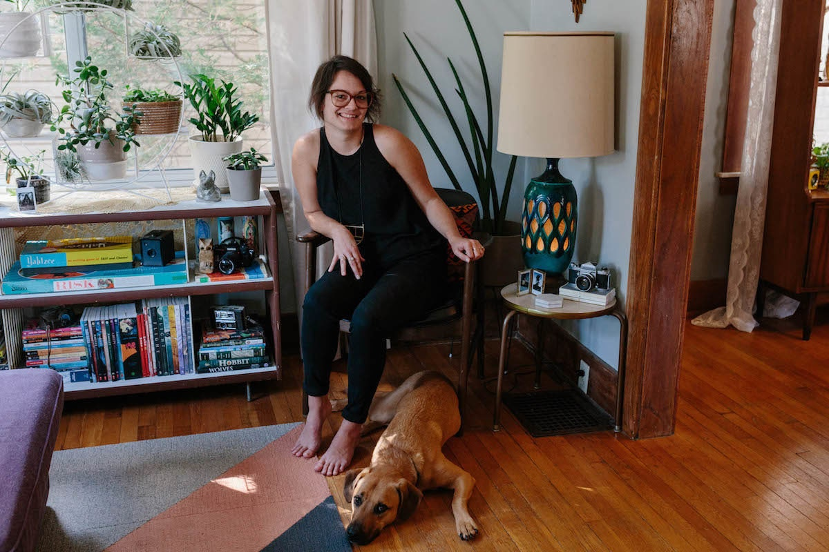 Brenda in her home with her dog