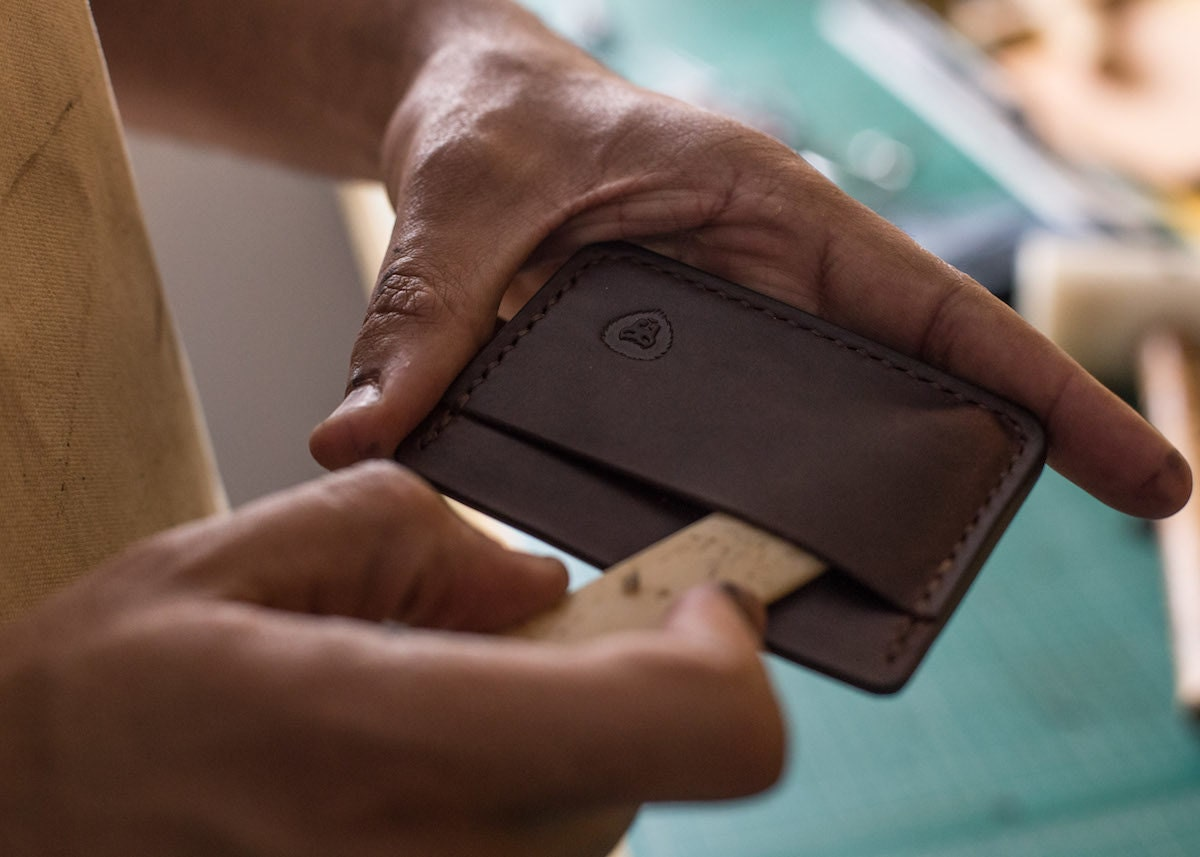 Kingsley at work on a card case