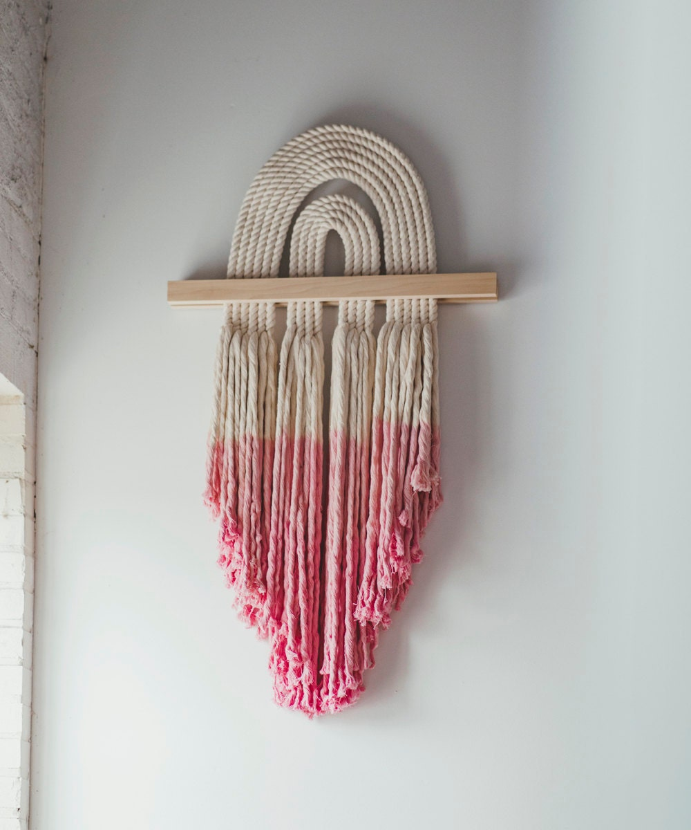 A pink dip-dyed macrame wall-hanging from Candice Luter