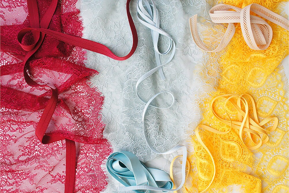 A spread of lacy fabrics in primary colors