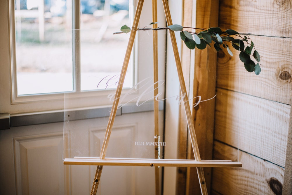 """An acrylic name sign that Emily designed for her wedding day reads """"The Allens"""""""