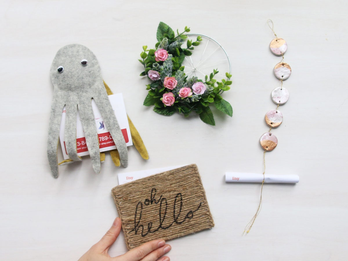 Four playful DIY gift card carriers in the shape of an octopus, wreath, doormat, and moon phase ornament