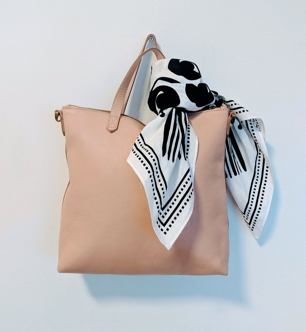 An everyday bag made glam with the addition of a scarf tied on the handle, from All the Very Goods.